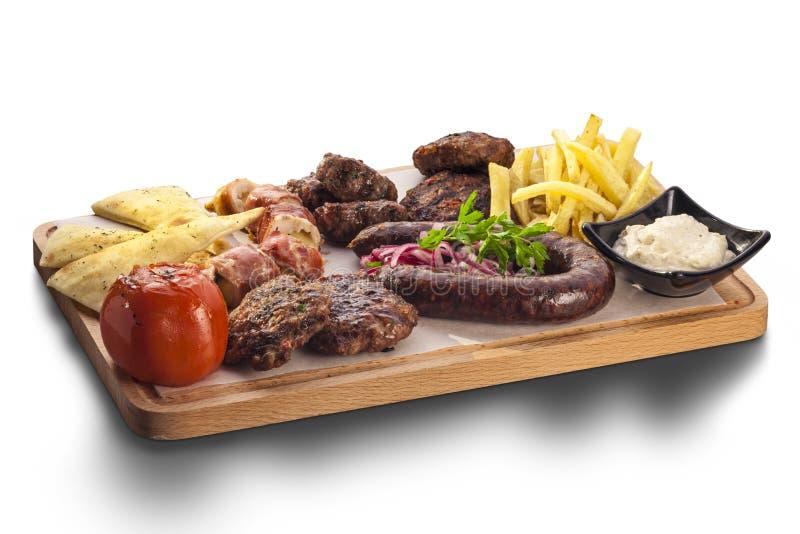 Полезный диск смешанных мяс включая зажаренный стейк стоковые изображения