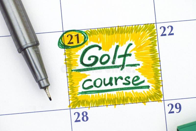 Поле для гольфа напоминания в календаре с ручкой стоковое изображение rf
