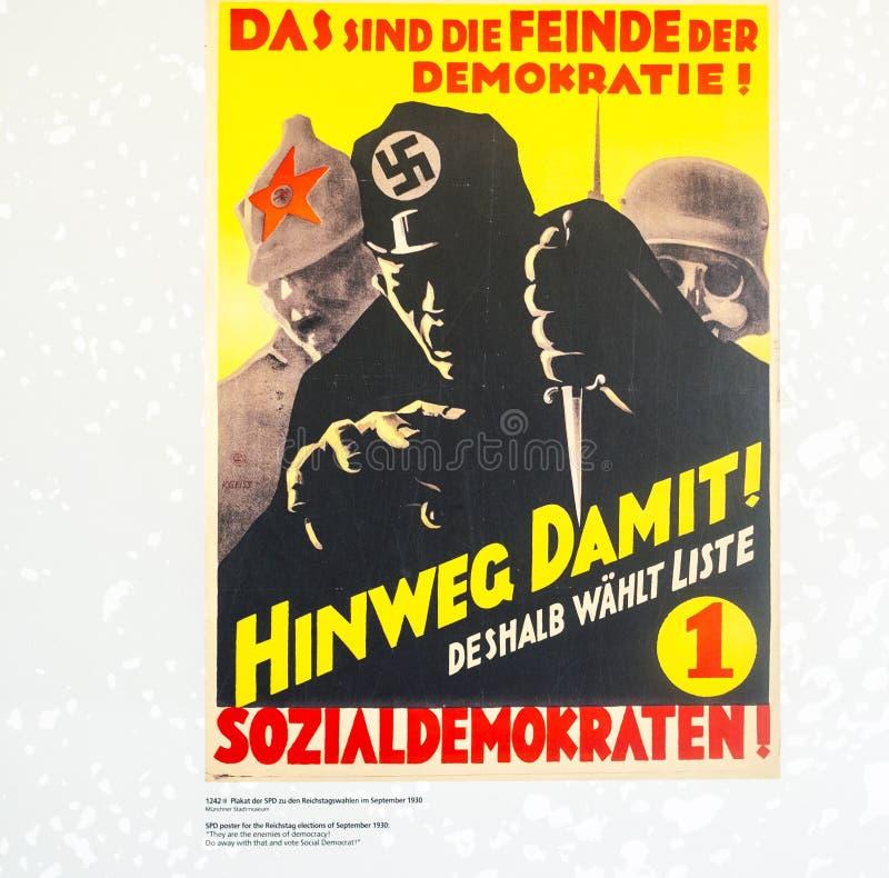 Политические плакаты афиши немецкой нацистской партии, который подвергли действию внутри стоковое фото rf