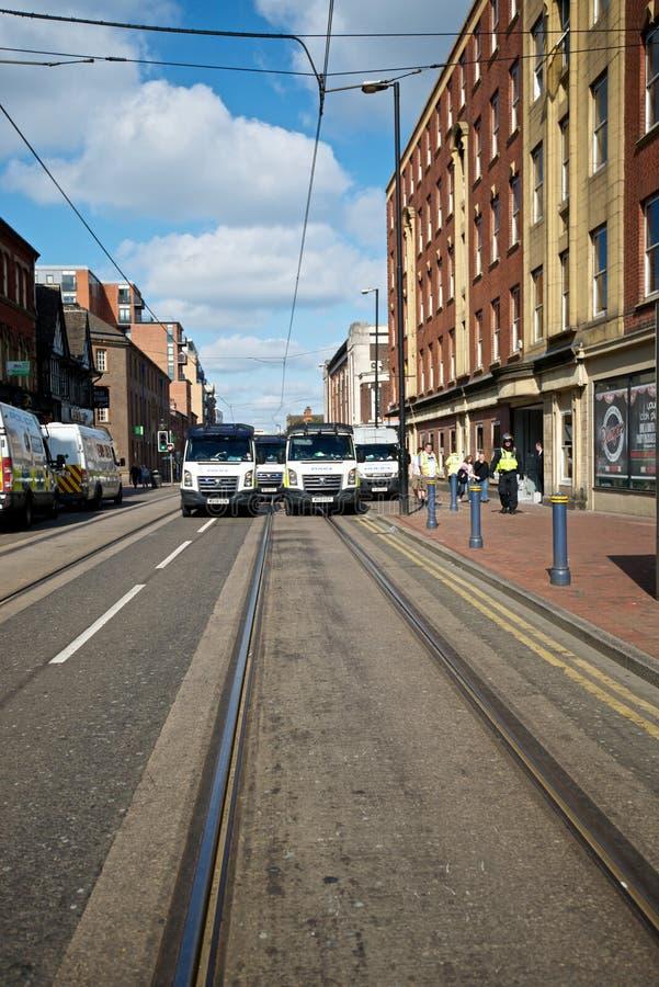 Полицейские фургоны формируя блокаду стоковое фото