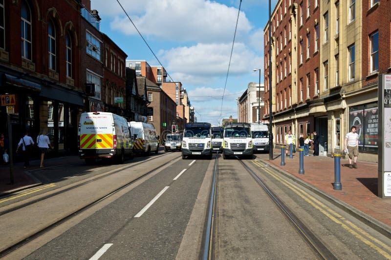Полицейские фургоны формируя блокаду стоковые фото