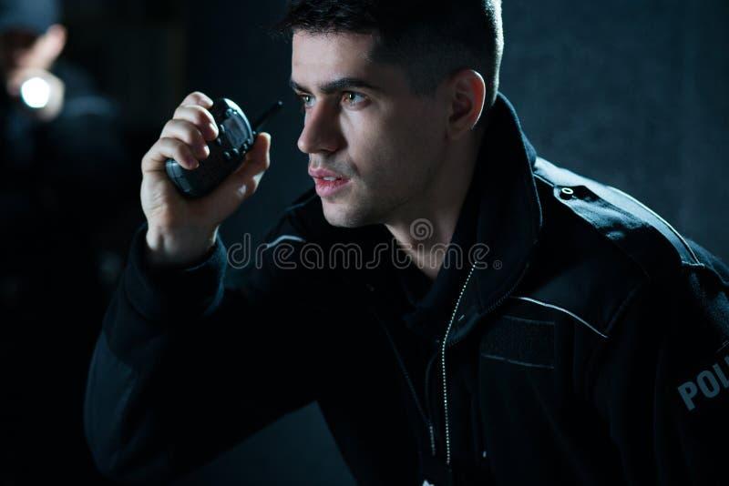 Полицейский на действии стоковые изображения