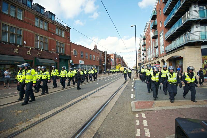 Полиция по охране общественного порядка возвращающ к их кораблям после протеста стоковое изображение