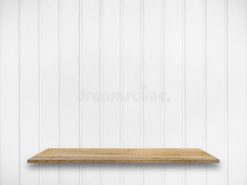 Полка дисплея на белой предпосылке стены панели стоковое фото