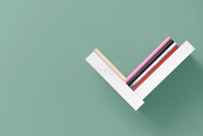 Полка книг на стене стоковое фото rf