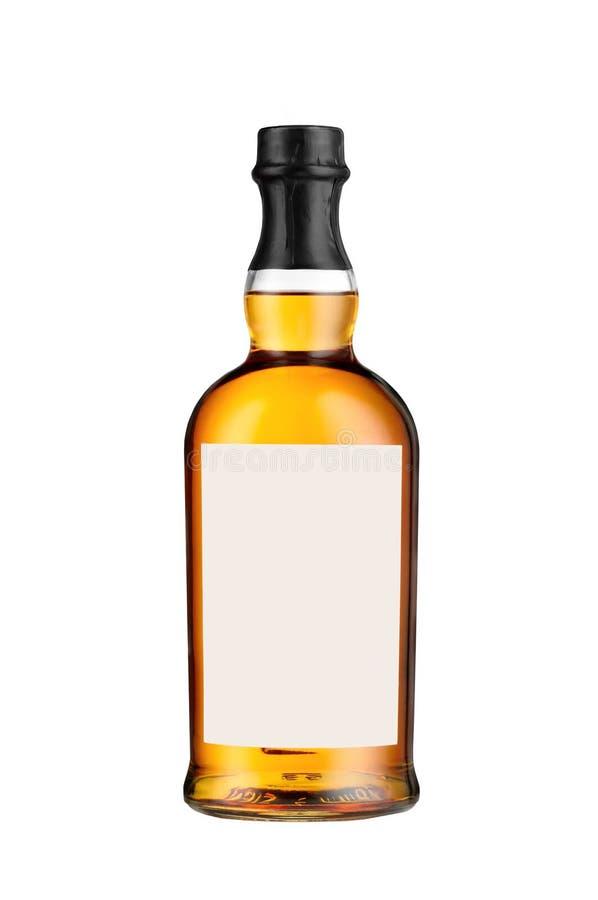 Полная изолированная бутылка вискиа стоковые изображения rf