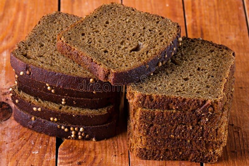 Download поднимающее вверх хлеба близкое Стоковое Изображение - изображение насчитывающей черный, темно: 40591751