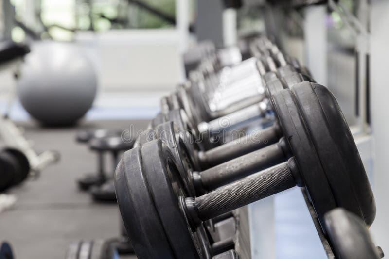 поднимаясь вес вектора человека мышечный стоковые фото
