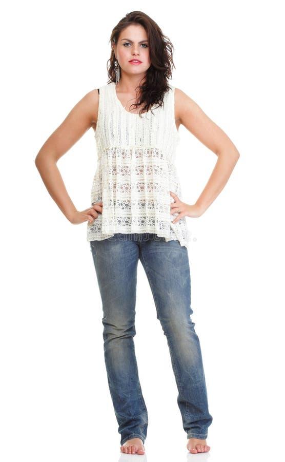 Полнометражный портрет милый представлять молодой женщины стоковое изображение