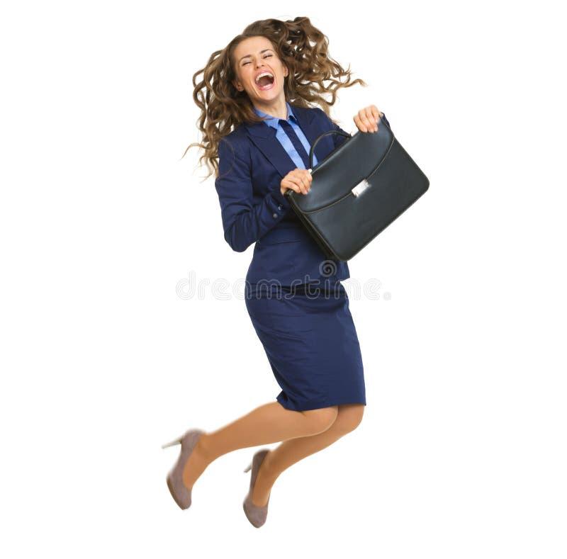 Полнометражный портрет усмехаясь скакать бизнес-леди стоковые изображения