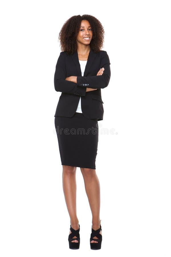 Полный портрет тела молодой усмехаться бизнес-леди стоковое изображение