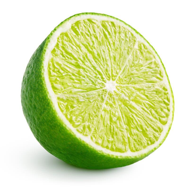 Половина цитрусовых фруктов известки изолированных на белизне стоковое изображение