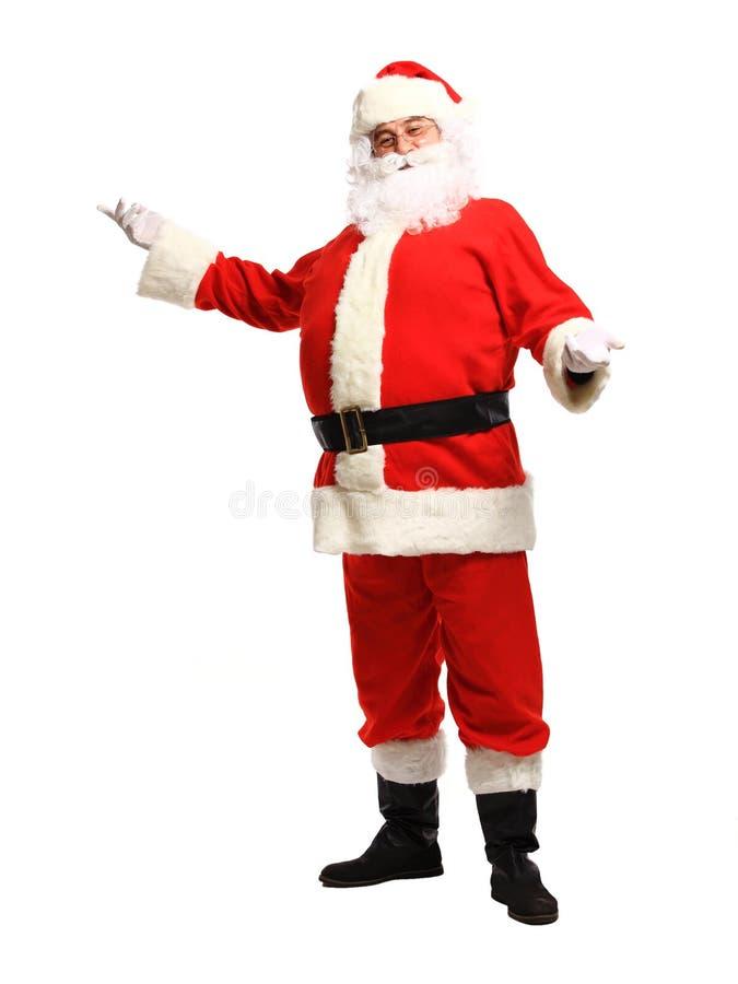 Положение Санта Клауса изолированное на белой предпосылке - во всю длину стоковое фото
