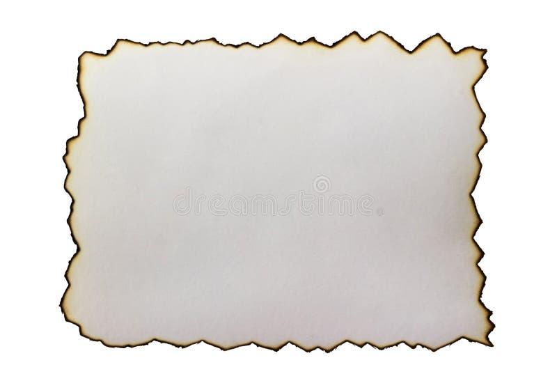 Подпаленный на краях изолированной бумаги стоковое фото rf