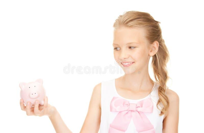 подростковое девушки банка симпатичное piggy стоковая фотография rf