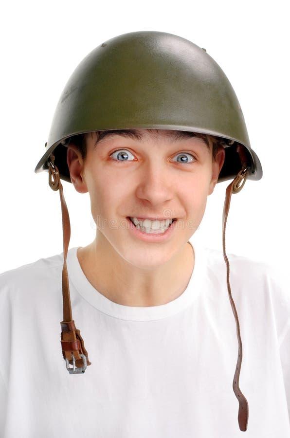 Подросток в воинском шлеме стоковые фотографии rf