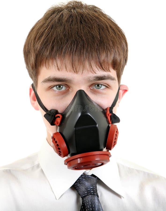 Подросток в маске противогаза стоковая фотография