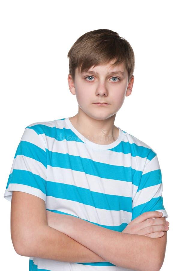 подросток мальчика серьезный стоковое изображение