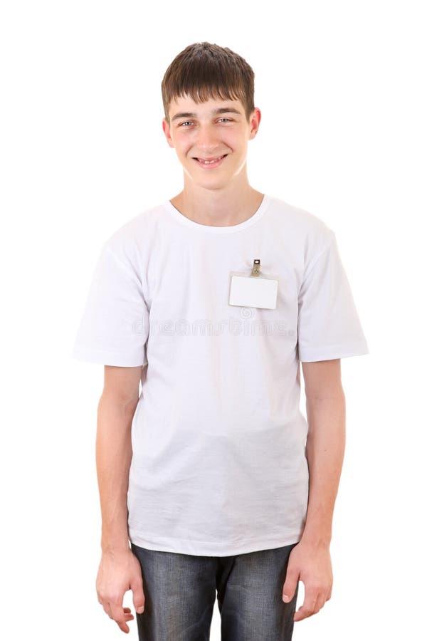 Подросток с пустым значком стоковое фото rf