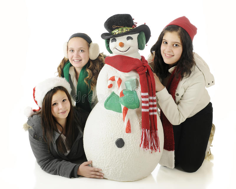 Подросток с снеговиком рождества стоковые фото