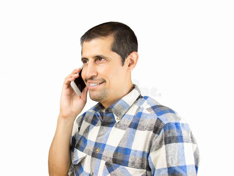 Подрядчик вызывая телефоном стоковое фото