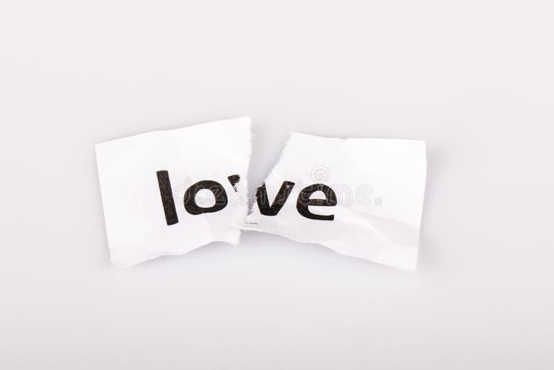 Download Полюбите слово написанное на сорванной бумаге на белизне Стоковое Фото - изображение насчитывающей вырез, влюбленность: 40582166