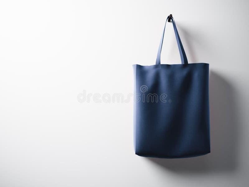 Правильная позиция смертной казни через повешение сумки ткани хлопка фото голубая Пустая белая предпосылка стены Сильно детальная стоковое фото