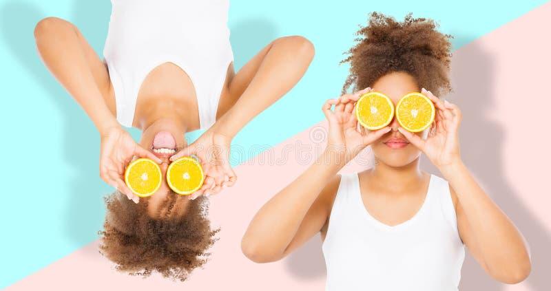 Праздники временени Красивые молодые Афро-американские женщины с оранжевым коллажем еды плода изолировали Девушка Афро и концепци стоковое фото