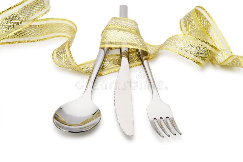 праздничная ложка тесемки ножа вилки связанная вверх стоковое фото