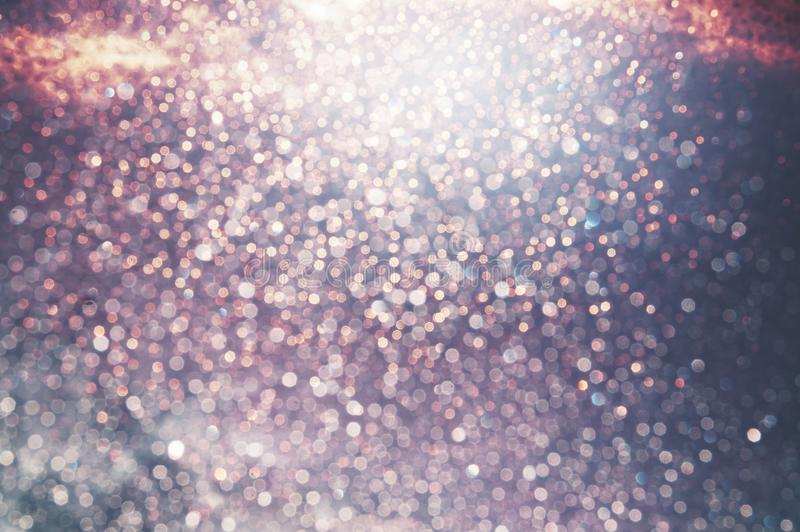 Праздничная сияющая glittery предпосылка bokeh события стоковое фото