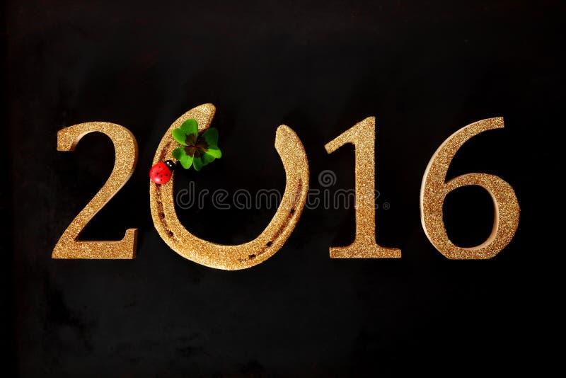 Праздничная предпосылка 2016 Новых Годов с подковой стоковое изображение rf
