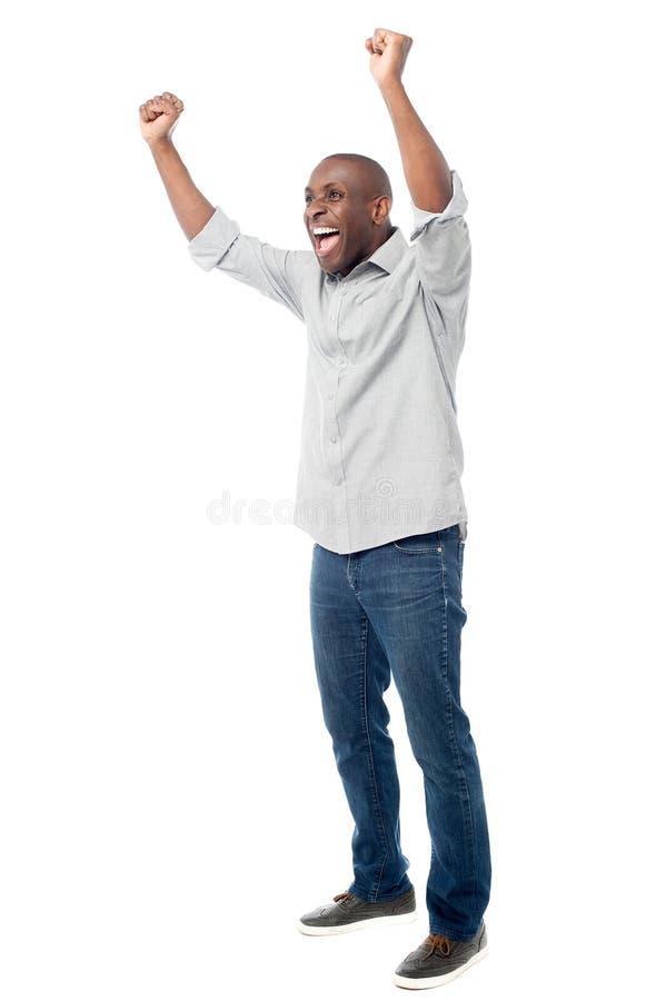 праздновать счастливый его успех человека стоковые фото
