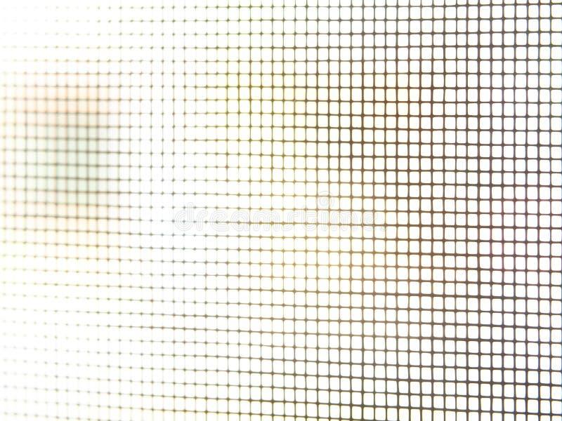 Предохранение от сети nilon черноты экрана сетки москита от насекомого приходит в дом, конец-вверх, селективный фокус стоковое фото