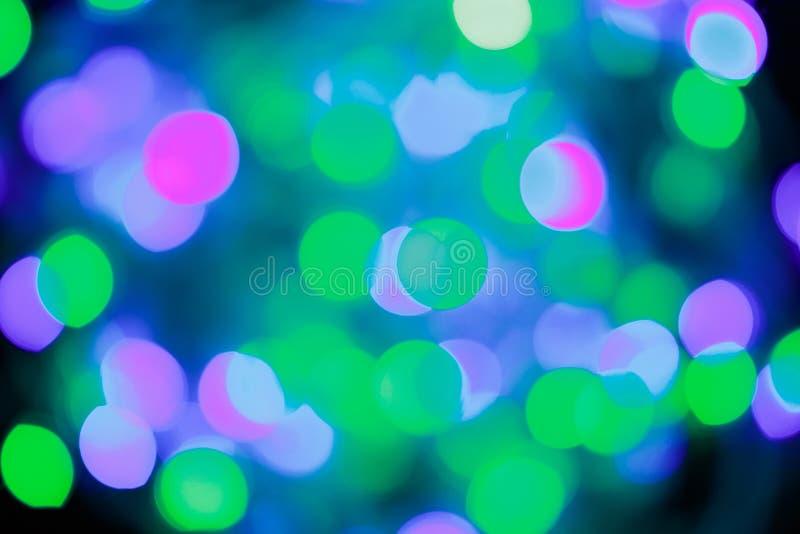 Предпосылка голубого и зеленого праздничного рождества элегантная абстрактная со светами и звездами bokeh стоковое фото