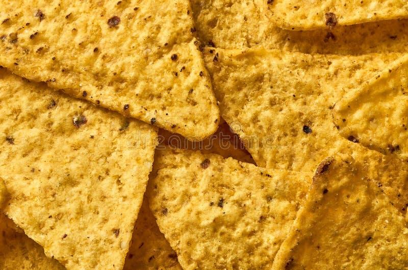 Предпосылка желтого триангулярного конца-вверх nachos мозоли стоковая фотография