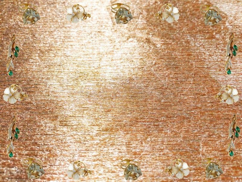 Предпосылка золота с ювелирными изделиями стоковая фотография rf