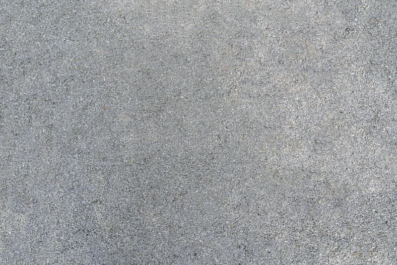 Текстура серого гравия предпосылка камней для бетона стоковое фото