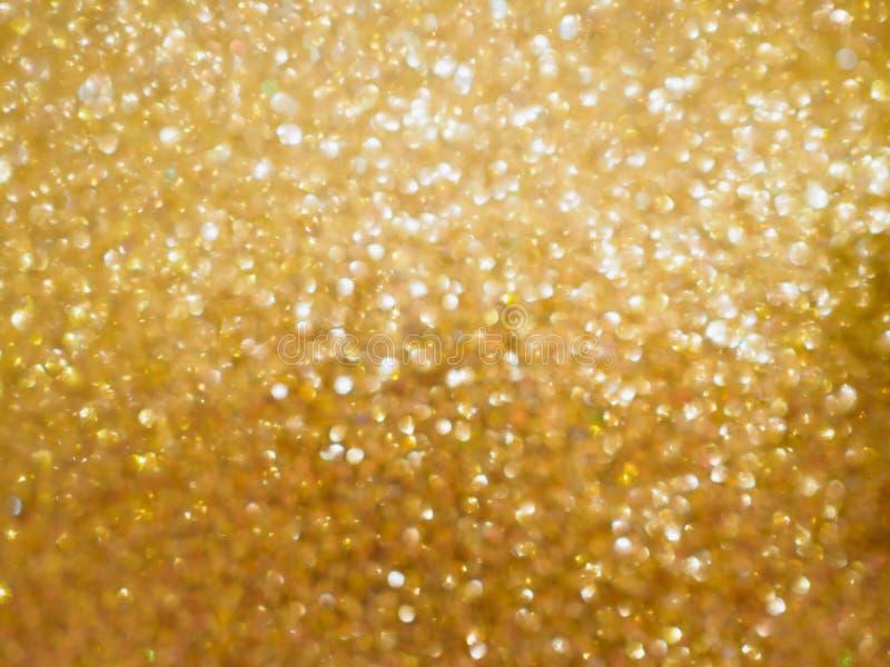 Предпосылка нерезкости света bokeh золотого зарева рождества стоковые изображения