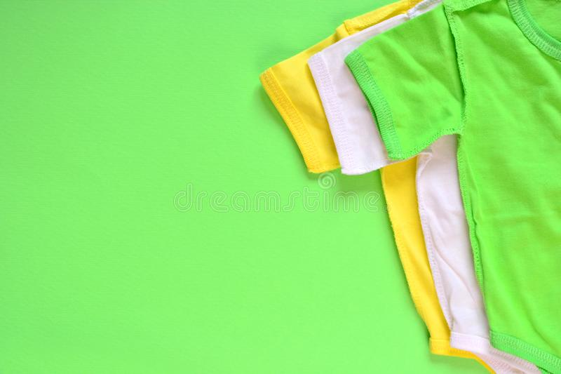 Предпосылка одежд bodysuit младенца стоковое изображение rf