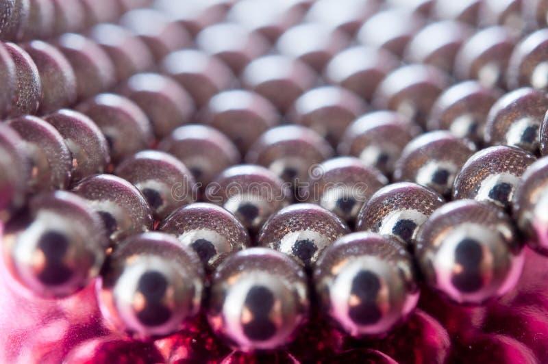 предпосылка отбортовывает розовое глянцеватое стоковое изображение