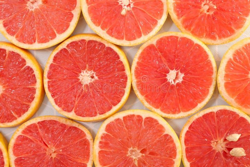 Предпосылка отрезанная грейпфрутом стоковое фото rf