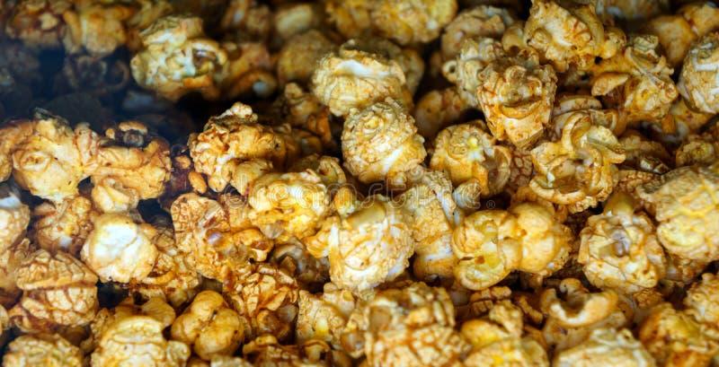 Предпосылка попкорна карамельки стоковые фотографии rf
