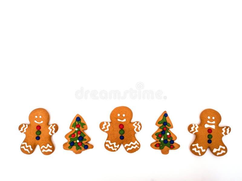 Предпосылка пряника С Новым Годом! и веселое рождества белая ароматичные специи gingerbread печений рождества выпечки Делать пече стоковое изображение
