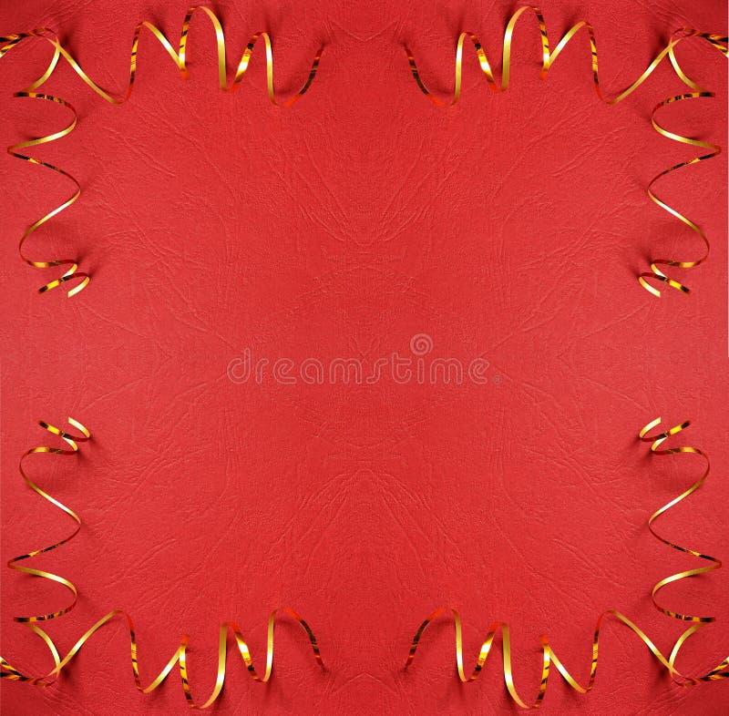 Предпосылка рождества красная с золотыми лентами в углах стоковые фото