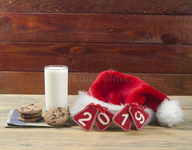 Предпосылка рождества с молоком и печеньями к Санта стоковая фотография