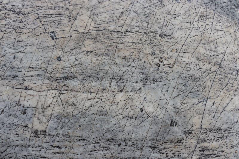 Предпосылка серого камня с много сломленных длинных очередей стоковые фото