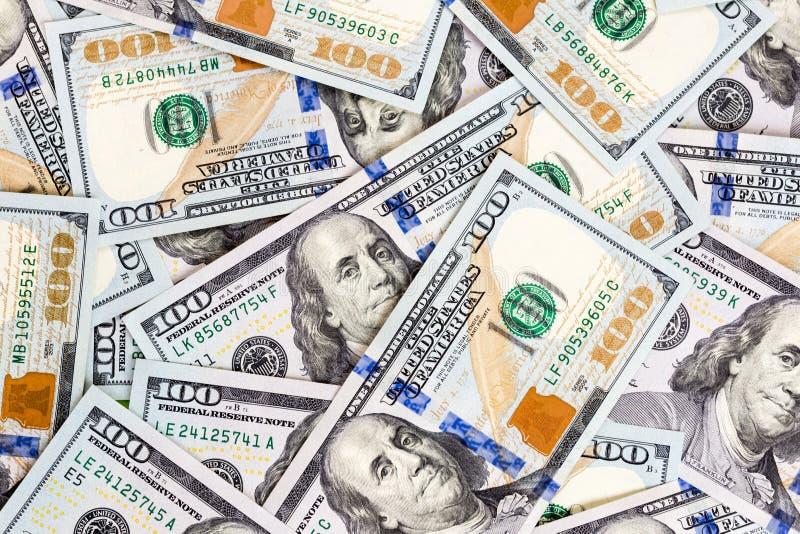 Предпосылка 100 счетов доллара E кренить финансы стоковые изображения