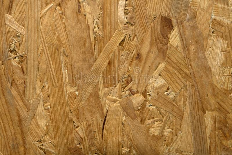 Предпосылка, текстура деревянной опилк, макулатурного картона стоковое изображение