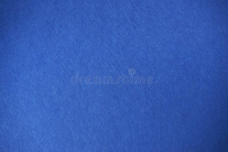 Предпосылка текстуры войлока сини стоковая фотография rf