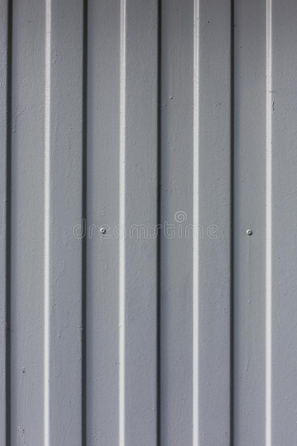 Предпосылка текстуры картины вертикальных нашивок поверхности металла стоковое изображение